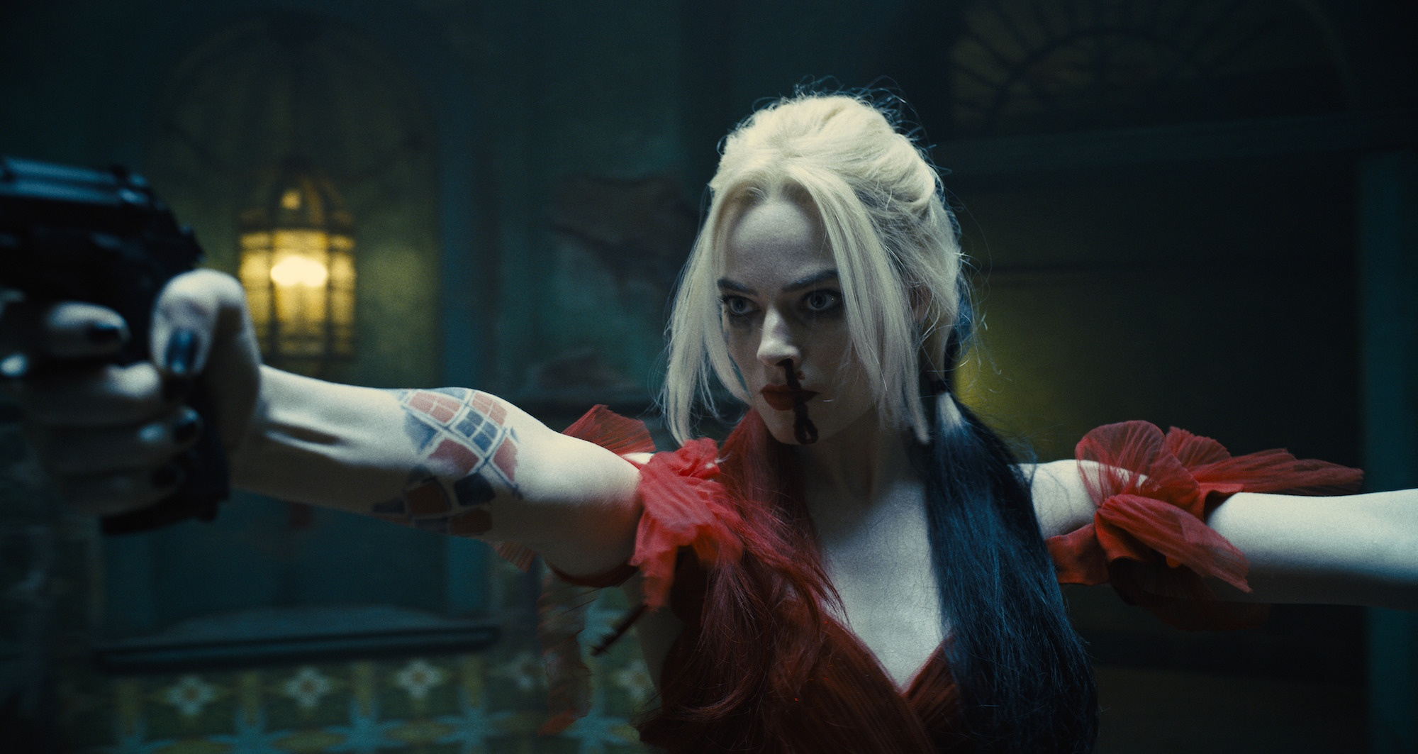 """TSS-TRL2-88883 Film Name: THE SUICIDE SQUAD Copyright: © 2021 Warner Bros. Entertainment Inc. All Rights Reserved. Photo Credit: Courtesy of Warner Bros. Pictures/™ & © DC Comics Caption: MARGOT ROBBIE as Harley Quinn in Warner Bros. Pictures' superhero action adventure """"THE SUICIDE SQUAD,"""" a Warner Bros. Pictures release."""